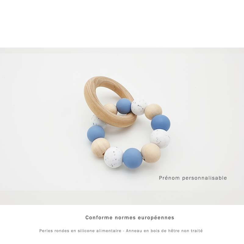 Anneau de dentition silicone bleu et marbré personnalisable au prénom de l'enfant.