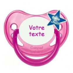 """Tétine personnalisée pour bébé au prénom de l'enfant  qui brille dans la nuit """"rose fluo""""."""